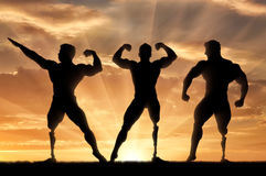 Paralympic bodybuilders with prosthetic leg sunset Stock Photos