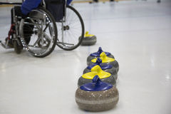 The Paralympic curling training wheelchair curling. Invalid sport Stock Photo