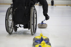 The Paralympic curling training wheelchair curling. Invalid sport Royalty Free Stock Photo