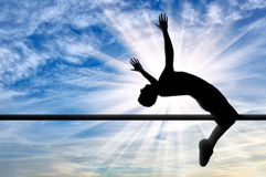 Paralympic handicapped with artificial limb jumps over the crossbar Royalty Free Stock Photos