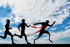 Paralympic runner with prosthesis and normal runners Royalty Free Stock Photos