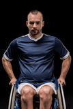 Paralympic in wheelchair dressed in sportswear looking at camera Stock Photo