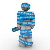 Paralyzed Bound by Indecision Make a Choice or Die. An illustrated person stands wrapped up in tape marked Indecision illustrating that a failure to make an Royalty Free Stock Photo