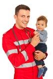 Paramédico y bebé felices Imagen de archivo