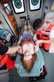 Paramédicos que usam o equipamento médico Foto de Stock Royalty Free