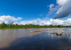 Free Paramaribo, Suriname - August 2019: Traditional Boat With Passengers Sailing Along The Suriname River. Stock Photos - 185707333