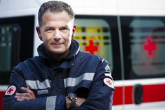 Paramedic. Portrait of a male paramedic, ambulance in the background Royalty Free Stock Photo