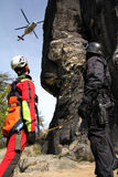 Paramedic. Rescuer helps injured on a rock by helicopter Stock Images