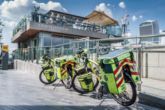 Paramedic ambulance biycles parked by. LONDON, UK - MAY 12, 2016: Paramedic ambulance biycles parked by cafe on the Thames Stock Images