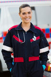 Paramedic ambulance. Portrait of paramedic in front of ambulance Royalty Free Stock Photography