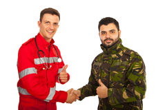 Paramedic and army man shaking Royalty Free Stock Photos