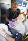 Paramedic attending to patient in ambulance Royalty Free Stock Photos