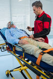 Paramedic checking blood pressure of patient stock photography