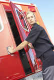 Paramedic closing ambulance doors Royalty Free Stock Photos