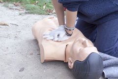Paramedic demonstrates CPR on a dummy Stock Photography