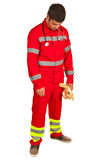Paramedic disappointed. Looking down and holding plush toy  isolated on white background Stock Photo