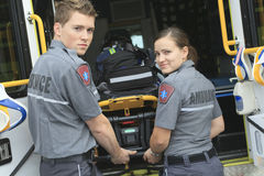 Paramedic employee with ambulance Royalty Free Stock Image