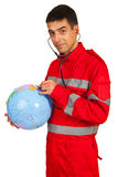Paramedic examine world globe Stock Photography