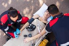 Paramedic examining patient royalty free stock photography