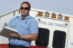 Paramedic In Front Of Ambulance royalty free stock images