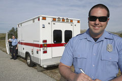 Paramedic In Front Of Ambulance Stock Photo