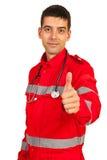 Paramedic giving thumb Royalty Free Stock Image