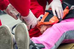 Paramedic helping a injured girl Royalty Free Stock Photography