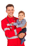 Paramedic holding baby boy Royalty Free Stock Images