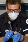 Paramedic intubating. Paramedic  hold medical equipmne tused for intubation Stock Photo