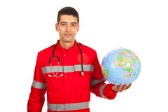 Paramedic man holding world globe Stock Images