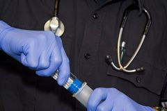 Paramedic and Medication. Paramedic putting togather a preloaded medication medication Royalty Free Stock Image