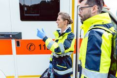 Paramedic nurse and emergency doctor at ambulance stock photo