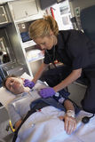 Paramedic with patient in ambulance Stock Photo