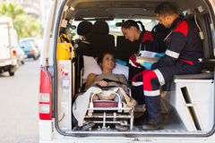 Paramedic patient ambulance. Caring paramedic talking to patient in ambulance Royalty Free Stock Image