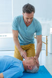 Paramedic performing resuscitation on patient Royalty Free Stock Photos