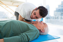 Paramedic performing resuscitation on patient stock images