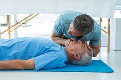 Paramedic performing resuscitation on patient. In clinic royalty free stock photos