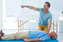 Paramedic performing resuscitation on patient. In clinic Royalty Free Stock Image