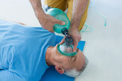 Paramedic performing resuscitation on patient. In clinic Stock Photo
