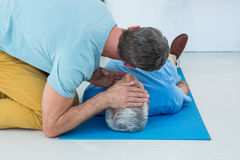 Paramedic performing resuscitation on patient. In clinic Royalty Free Stock Photo