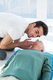 Paramedic performing resuscitation on patient. In clinic stock photos