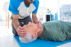 Paramedic performing resuscitation on patient. In clinic royalty free stock photography