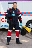Paramedic portable medical equipments. Happy indian paramedic carrying portable medical equipments Royalty Free Stock Photos