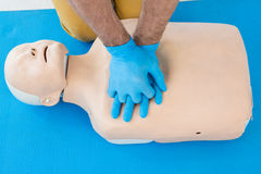 Paramedic practising cardiopulmonary resuscitation on dummy. In clinic royalty free stock photos