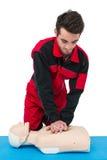 Paramedic practising resuscitation on dummy stock image