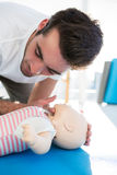 Paramedic practising resuscitation on dummy Stock Photos