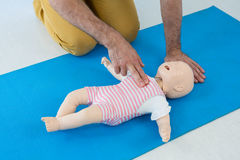 Paramedic practising resuscitation on dummy. In clinic Royalty Free Stock Image