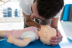 Paramedic practising resuscitation on dummy. In clinic Stock Image