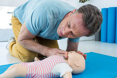 Paramedic practising resuscitation on dummy. In clinic Stock Images