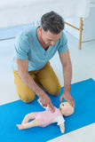 Paramedic practising resuscitation on dummy. In clinic Royalty Free Stock Photo